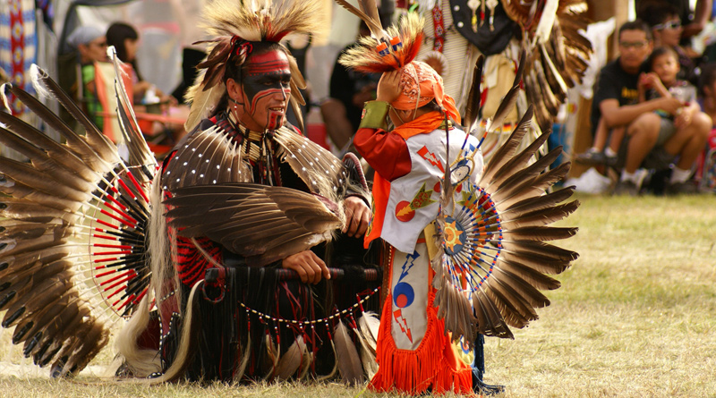 Atikamekw in dance clothes at the powwow site in Manawan, Quebec, Canada.